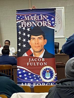 The Falls County Post 31 American Legion is honoring service members by hanging banners in Downtown Marlin.