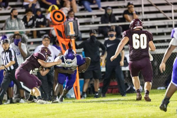 Marlin's Ty Harris gains yardage against the Milano Eagles on Friday night. The Bulldogs got their first win of the season 21-0 on the road Friday night. Photo courtesy of Steve Young