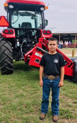 Maverick Cannon, age 9, son of Liz and Maverick Cannon awarded belt buckle: Junior Showmanship 2020 at the Falls County Junior Fair. California Rabbit, white  1st time time showing the rabbit.