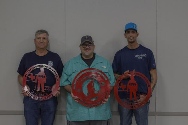 Raymond Skala (Honor), Michael Behke (Fire Fighter of the Year), and Channing Wright (Valor) received personalized metal decals at the Falls County First Responders Dinner.
