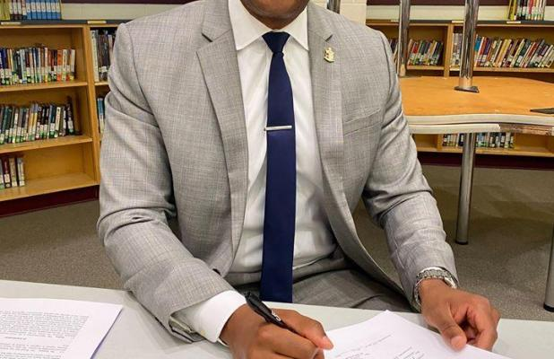 Dr. Daryll Henson officially signed his contract to be the Superintendent of Marlin ISD on May 20. photo caption 2: Dr. Henson was supported on the day of contract signing by his parents and brother, all of whom drove in from different parts of the state. (photos by Marlin ISD)
